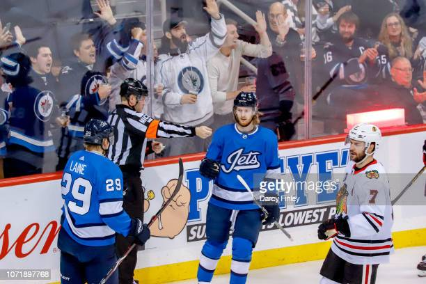 Patrik Laine and Kyle Connor of the Winnipeg Jets celebrate a second period goal against the Chicago Blackhawks at the Bell MTS Place on December 11...