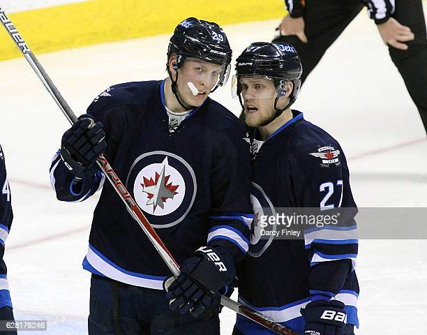 Patrik Laine and Nikolaj Ehlers of the Winnipeg Jets discuss strategy during a second period stoppage in play against the Detroit Red Wings at the...