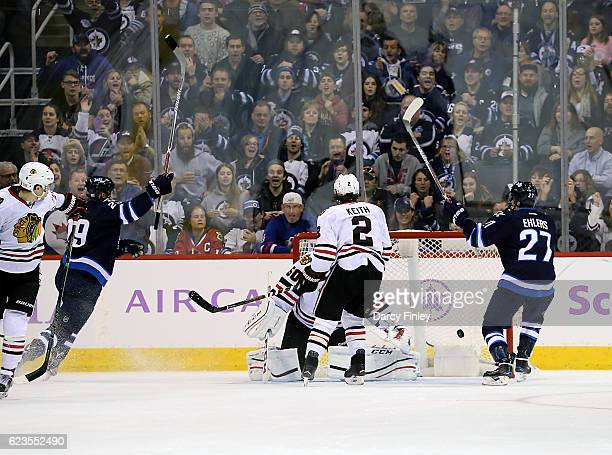 Patrik Laine and Nikolaj Ehlers of the Winnipeg Jets raise their arms to celebrate a third period goal against the Chicago Blackhawks at the MTS...