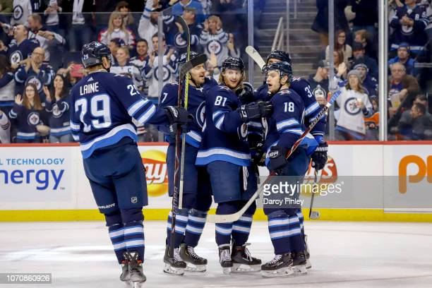 Patrik Laine Ben Chiarot Kyle Connor Dustin Byfuglien and Bryan Little of the Winnipeg Jets celebrate a first period goal against the Philadelphia...