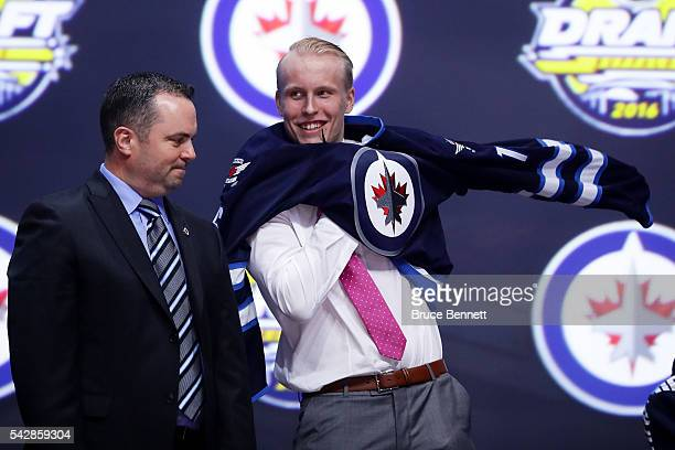 Patrik Laine celebrates after being selected second overall by the Winnipeg Jets during round one of the 2016 NHL Draft on June 24 2016 in Buffalo...
