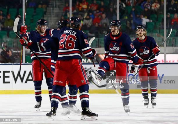 Patrik Laine, Josh Morrissey, Blake Wheeler, Mark Scheifele and Kyle Connor of the Winnipeg Jets celebrate Morrissey's tying goal in the third period...