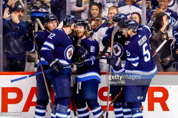 Patrik Laine Kevin Hayes Kyle Connor Tyler Myers and Dmitry Kulikov of the Winnipeg Jets celebrate a second period goal against the Nashville...