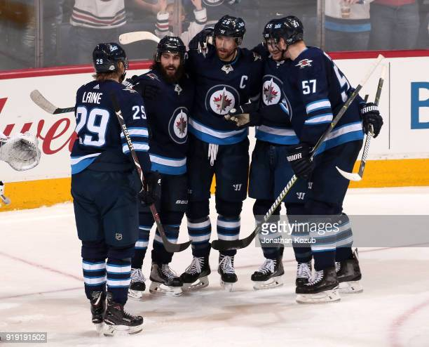 Patrik Laine Mathieu Perreault Blake Wheeler Mark Scheifele and Tyler Myers of the Winnipeg Jets celebrate a third period goal against the Colorado...