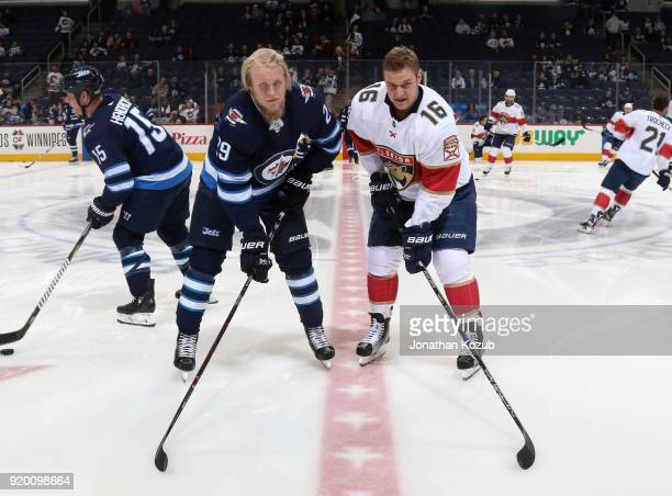 Patrik Laine of the Winnipeg Jets and Aleksander Barkov of the Florida Panthers pose for a photo prior to NHL action at the Bell MTS Place on...