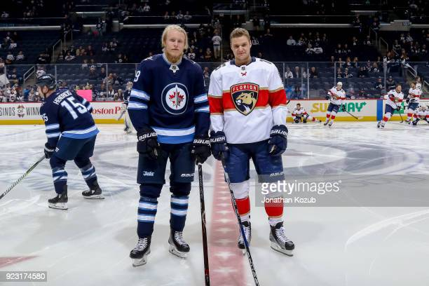 Patrik Laine of the Winnipeg Jets and Aleksander Barkov of the Florida Panthers pose prior to NHL action at the Bell MTS Place on February 18 2018 in...