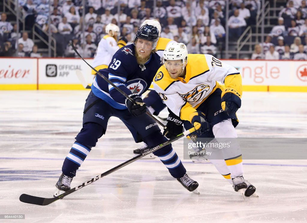 Patrik Laine #29 of the Winnipeg Jets and Miikka Salomaki #20 of the Nashville Predators follow the play down the ice during third period action in Game Four of the Western Conference Second Round during the 2018 NHL Stanley Cup Playoffs at the Bell MTS Place on May 3, 2018 in Winnipeg, Manitoba, Canada.