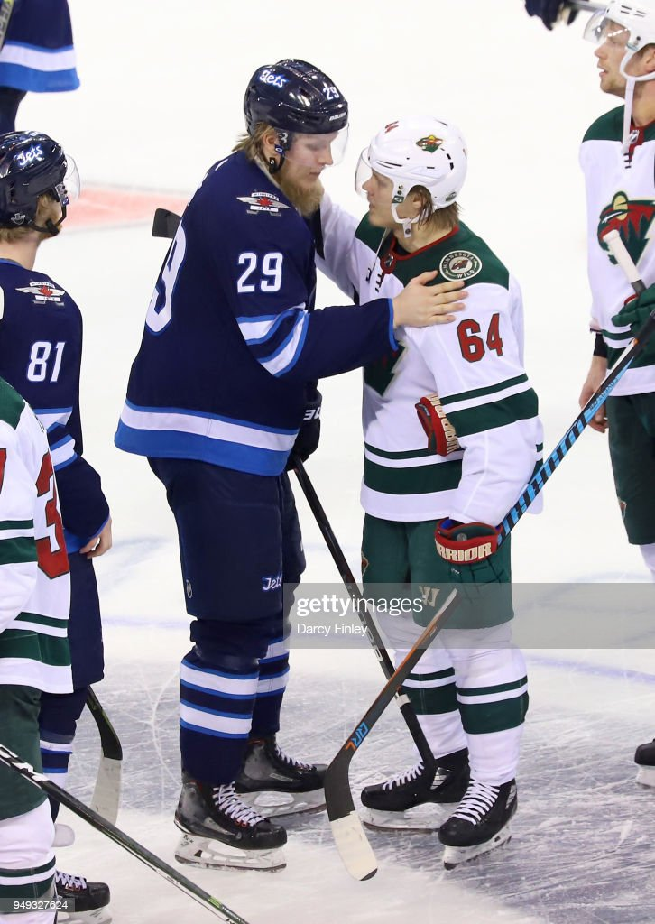 Patrik Laine #29 of the Winnipeg Jets and Mikael Granlund #64 of the Minnesota Wild shake hands following a 5-0 Jets victory in Game Five of the Western Conference First Round during the 2018 NHL Stanley Cup Playoffs at the Bell MTS Place on April 20, 2018 in Winnipeg, Manitoba, Canada. The Jets win the series 4-1.