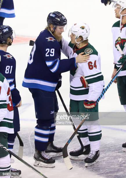 Patrik Laine of the Winnipeg Jets and Mikael Granlund of the Minnesota Wild shake hands following a 50 Jets victory in Game Five of the Western...