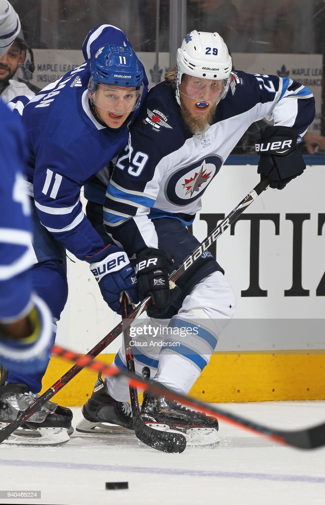 Patrik Laine #29 of the Winnipeg Jets battles against Zach Hyman #11 of the Toronto Maple Leafs during an NHL game at the Air Canada Centre on March 31, 2018 in Toronto, Ontario, Canada. The Jets defeated the Maple Leafs 3-1.