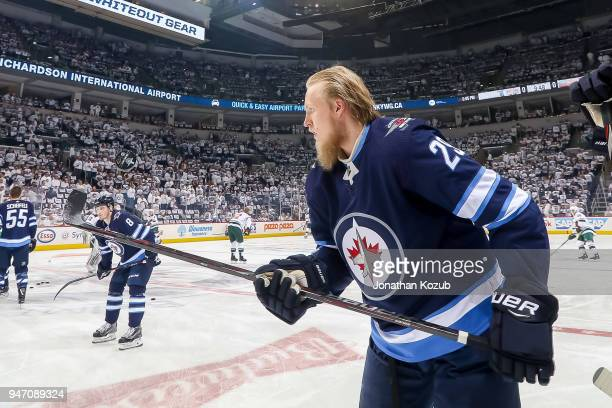 Patrik Laine of the Winnipeg Jets bounces the puck during the pregame warm up prior to NHL action against the Minnesota Wild in Game One of the...