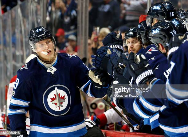 Patrik Laine of the Winnipeg Jets celebrates a first period goal against the Montreal Canadiens with teammates at the bench at the Bell MTS Place on...