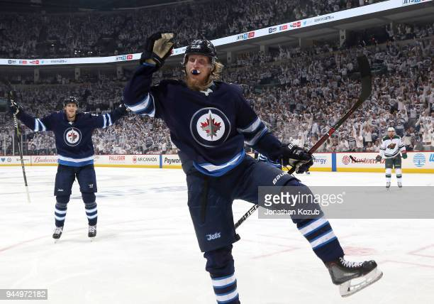 Patrik Laine of the Winnipeg Jets celebrates a third period goal against the Minnesota Wild in Game One of the Western Conference First Round during...