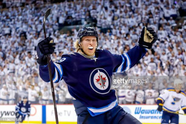 Patrik Laine of the Winnipeg Jets celebrates after scoring a first period goal against the St. Louis Blues in Game One of the Western Conference...