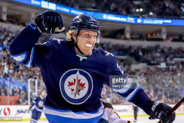 Patrik Laine of the Winnipeg Jets celebrates after scoring a second period goal against the Anaheim Ducks at the Bell MTS Place on January 13 2019 in...