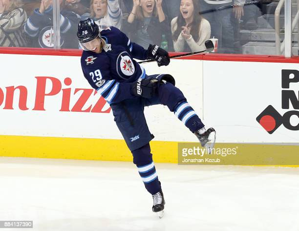 Patrik Laine of the Winnipeg Jets celebrates after scoring a third period goal against the Vegas Golden Knights at the Bell MTS Place on December 1...