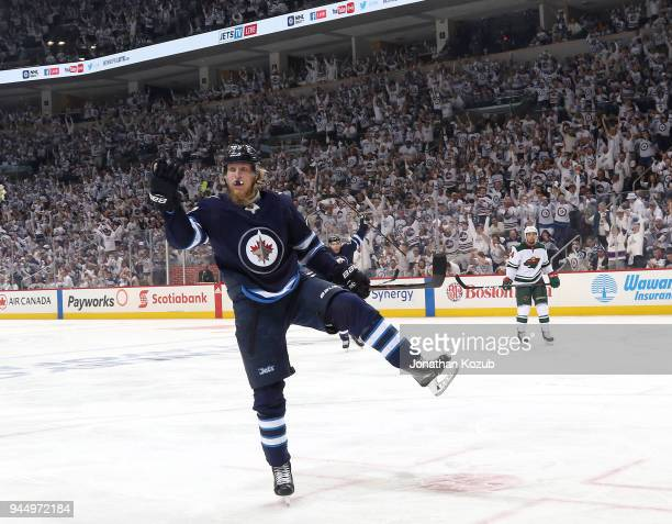 Patrik Laine of the Winnipeg Jets celebrates after scoring a third period goal against the Minnesota Wild in Game One of the Western Conference First...