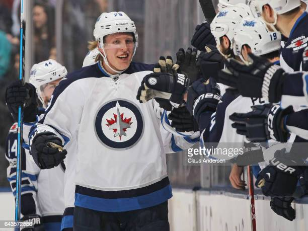Patrik Laine of the Winnipeg Jets celebrates his 30th goal of the season against the Toronto Maple Leafs during an NHL game at Air Canada Centre on...