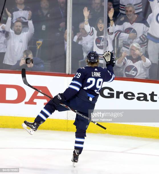 Patrik Laine of the Winnipeg Jets celebrates his goal against the Minnesota Wild in Game One of the Western Conference First Round during the 2018...