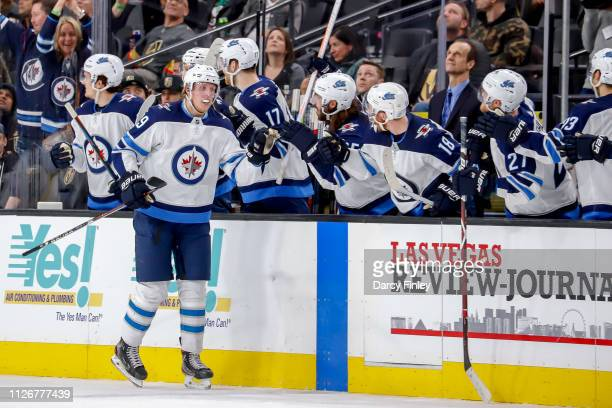 Patrik Laine of the Winnipeg Jets celebrates his second period goal against the Vegas Golden Knights with teammates at the bench at TMobile Arena on...
