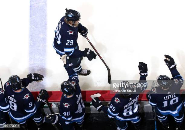 Patrik Laine of the Winnipeg Jets celebrates his second period goal against the Colorado Avalanche with teammates at the bench at the Bell MTS Place...