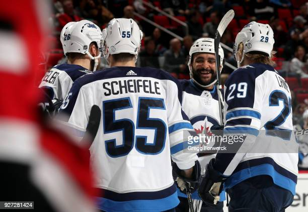 Patrik Laine of the Winnipeg Jets celebrates his second period goal against the Carolina Hurricanes with teammates Blake Wheeler Mark Scheifele and...