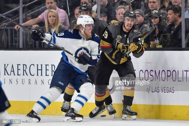 Patrik Laine of the Winnipeg Jets checks Reilly Smith of the Vegas Golden Knights in Game Four of the Western Conference Final during the 2018 NHL...
