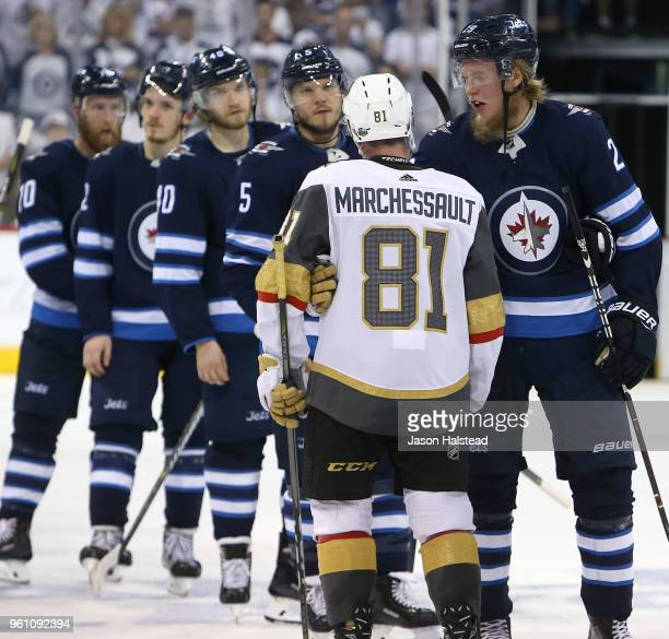 Patrik Laine of the Winnipeg Jets congratulates Jonathan Marchessault of the Vegas Golden Knights after Game Five of the Western Conference Finals...
