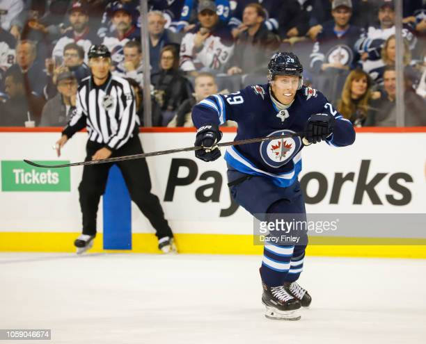Patrik Laine of the Winnipeg Jets follows the play down the ice during first period action against the St Louis Blues at the Bell MTS Place on...