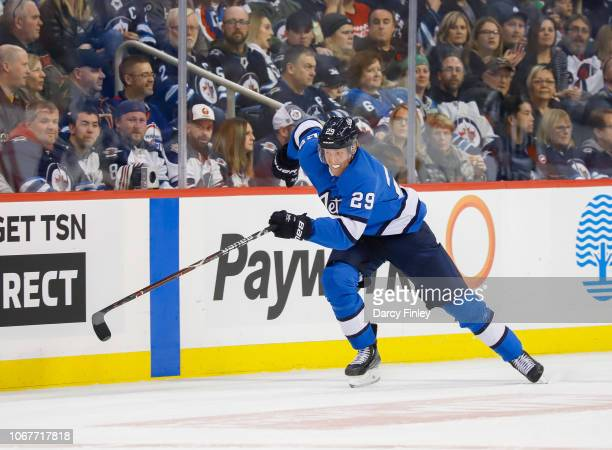 Patrik Laine of the Winnipeg Jets follows the play down the ice during second period action against the New Jersey Devils at the Bell MTS Place on...