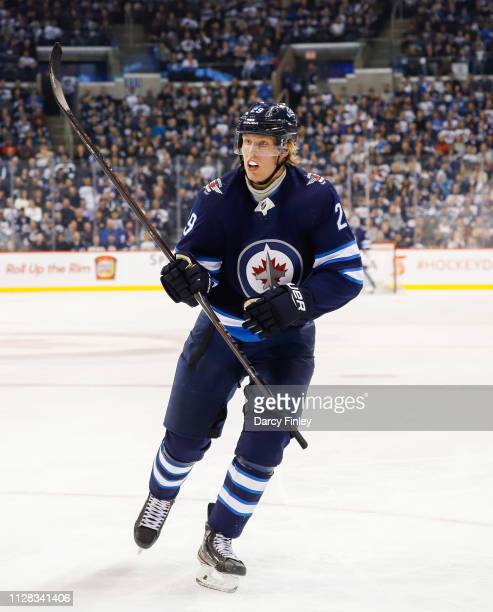 Patrik Laine of the Winnipeg Jets follows the play down the ice during second period action against the San Jose Sharks at the Bell MTS Place on...