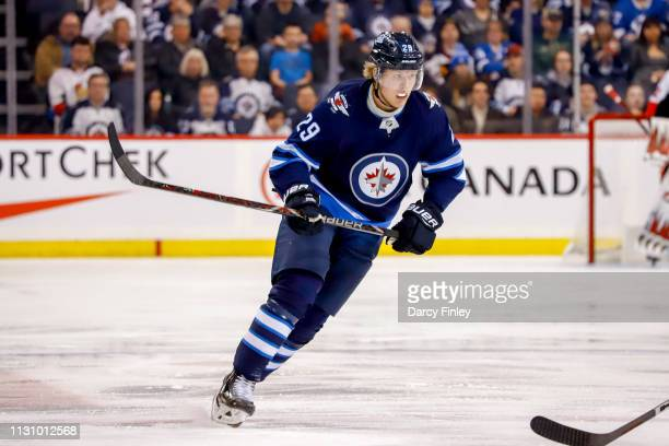 Patrik Laine of the Winnipeg Jets follows the play down the ice during third period action against the Ottawa Senators at the Bell MTS Place on...