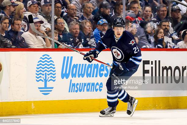 Patrik Laine of the Winnipeg Jets follows the play down the ice during first period action against the San Jose Sharks at the MTS Centre on January...