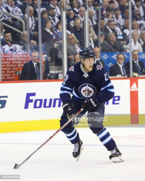 Patrik Laine of the Winnipeg Jets follows the play down the ice during second period action against the Pittsburgh Penguins at the Bell MTS Place on...