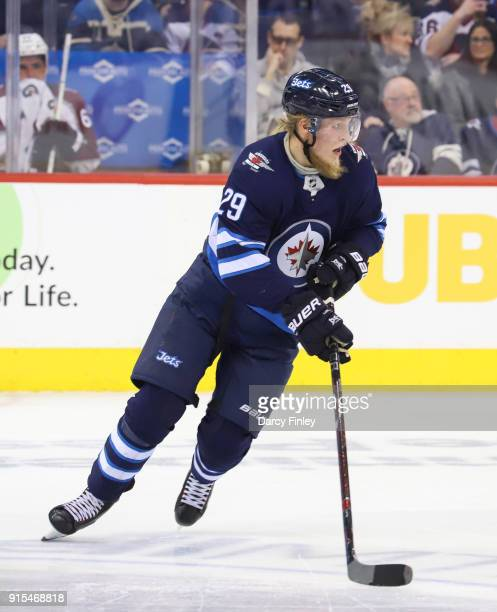 Patrik Laine of the Winnipeg Jets follows the play down the ice during second period action against the Colorado Avalanche at the Bell MTS Place on...