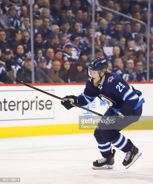 Patrik Laine of the Winnipeg Jets follows the play down the ice during second period action against the Washington Capitals at the Bell MTS Place on...