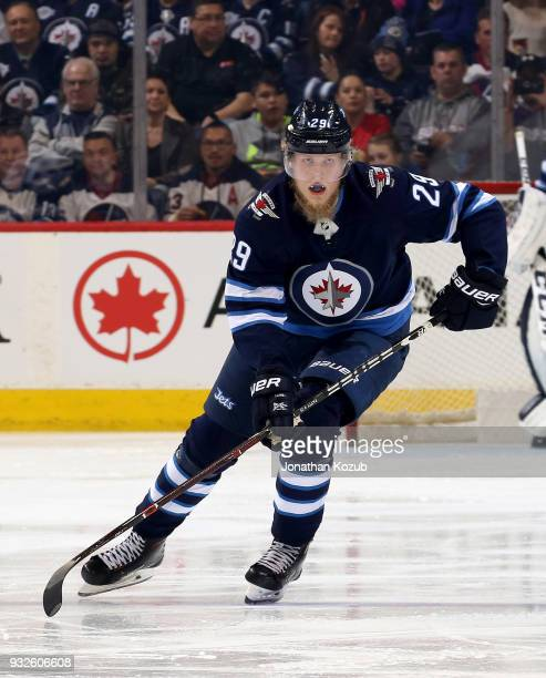 Patrik Laine of the Winnipeg Jets follows the play down the ice during second period action against the Chicago Blackhawks at the Bell MTS Place on...