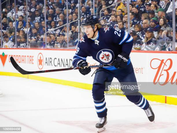 Patrik Laine of the Winnipeg Jets follows the play up the ice during first period action against the Anaheim Ducks at the Bell MTS Place on January...