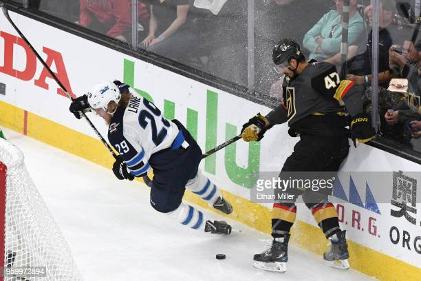 Patrik Laine of the Winnipeg Jets gets tripped up against Luca Sbisa of the Vegas Golden Knights during the first period in Game Four of the Western...