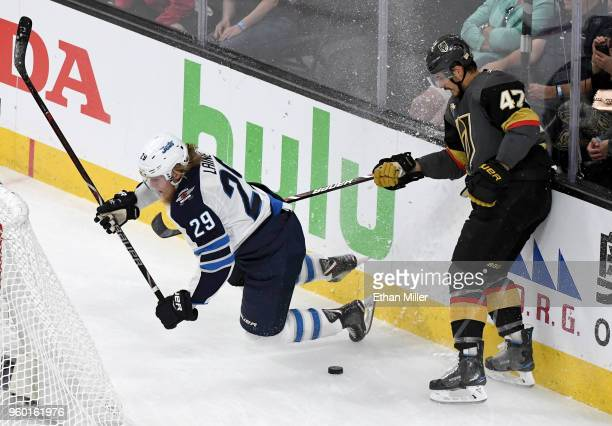 Patrik Laine of the Winnipeg Jets gets tripped up against Luca Sbisa of the Vegas Golden Knights during the first period of Game Four of the Western...