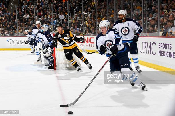 Patrik Laine of the Winnipeg Jets handles the puck against the Pittsburgh Penguins at PPG Paints Arena on February 16 2017 in Pittsburgh Pennsylvania