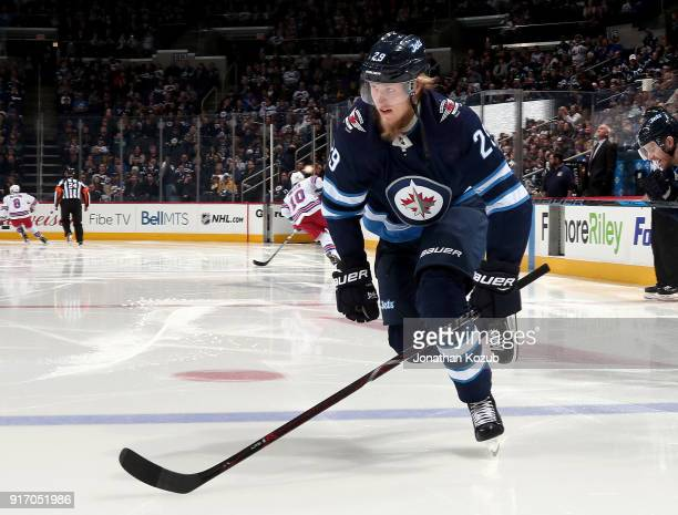 Patrik Laine of the Winnipeg Jets hits the ice prior to puck drop against the New York Rangers at the Bell MTS Place on February 11 2018 in Winnipeg...