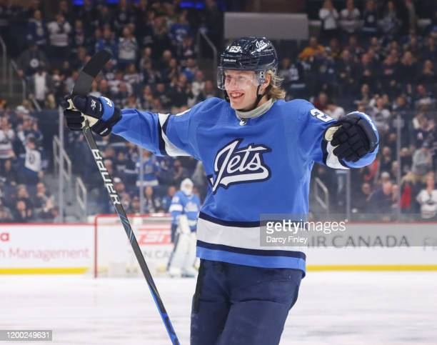 Patrik Laine of the Winnipeg Jets is all smiles as he celebrates a first period goal against the Vancouver Canucks at the Bell MTS Place on January...