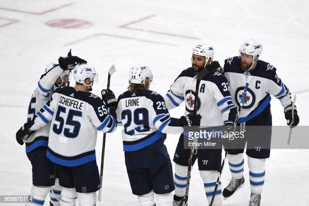 Patrik Laine of the Winnipeg Jets is congratulated by his teammates after scoring a secondperiod goal against the Vegas Golden Knights in Game Four...