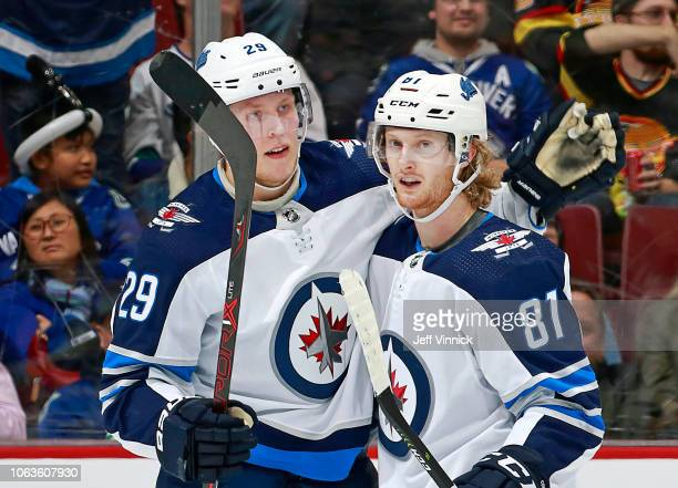 Patrik Laine of the Winnipeg Jets is congratulated by teammate Kyle Connor after scoring during their NHL game against the Vancouver Canucks at...