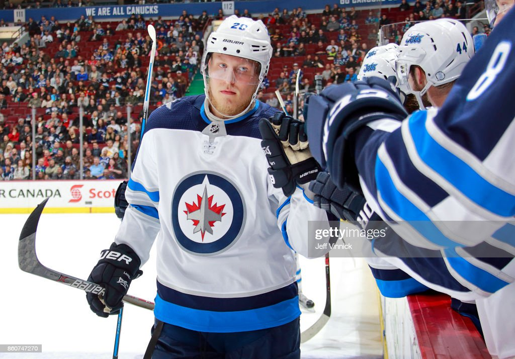 Patrik Laine #29 of the Winnipeg Jets is congratulated by teammates after scoring during their NHL game against the Vancouver Canucks at Rogers Arena October 12, 2017 in Vancouver, British Columbia, Canada. The final score was 4-2 for the Winnipeg Jets.