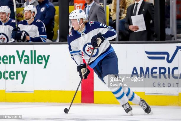 Patrik Laine of the Winnipeg Jets keeps an eye on the play during second period action against the Vegas Golden Knights at TMobile Arena on February...