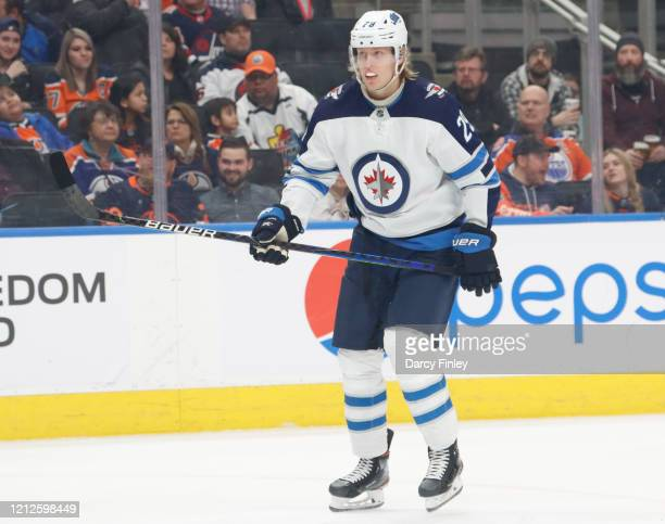 Patrik Laine of the Winnipeg Jets keeps an eye on the play during first period action against the Edmonton Oilers at Rogers Place on March 11, 2020...