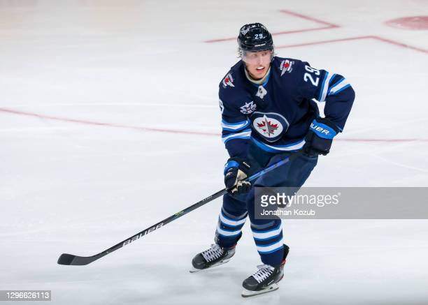 Patrik Laine of the Winnipeg Jets keeps an eye on the play during third period action against the Calgary Flames at Bell MTS Place on January 14,...