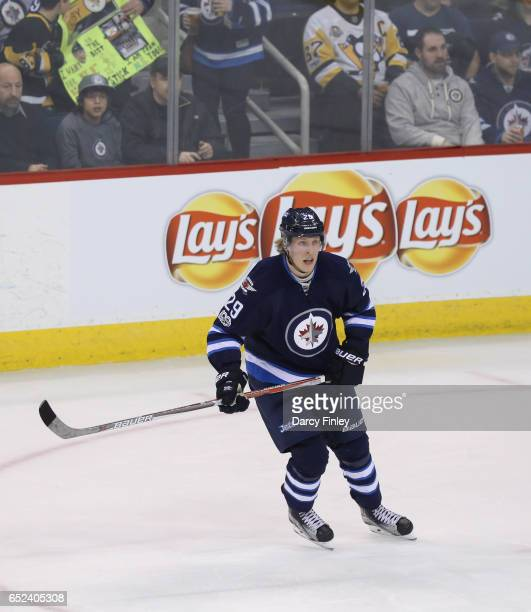 Patrik Laine of the Winnipeg Jets keeps an eye on the play during second period action against the Pittsburgh Penguins at the MTS Centre on March 8...